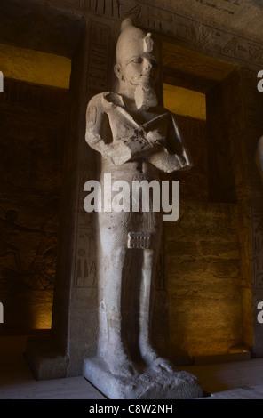 Egyptian art. Great Temple of Ramses II. First room. One statue of Ramses II as the god Osiris. Abu Simbel. Egypt. - Stock Photo