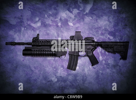 Assault rifle with grenade launcher on a grunge background. - Stock Photo