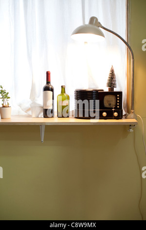 Wine Bottles, Clock, Lamp And Christmas Show Piece - Stock Photo