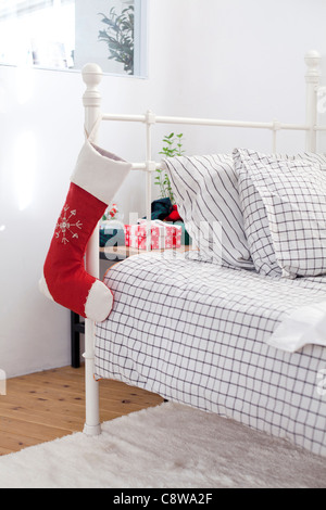 Christmas Stockings Hanging On Couch Handle - Stock Photo