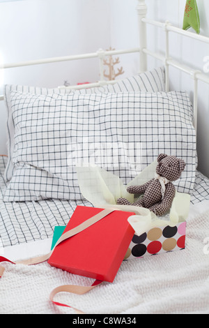 Teddy Bear In Unwrapped Gift Box - Stock Photo
