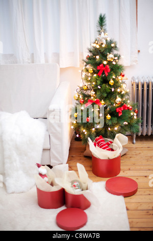 Room Interior With Unwrapped Christmas Gift Boxes And Christmas Tree - Stock Photo