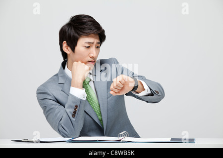 Asian Businessman At Office Desk - Stock Photo