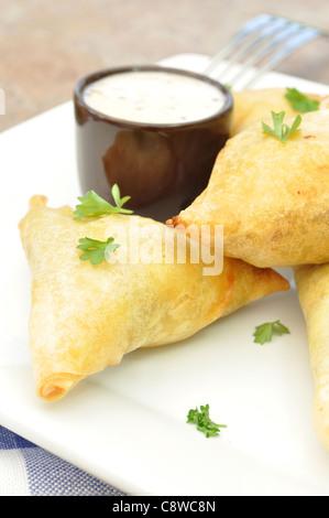 Mini feta and spinach phyllo triangles - Stock Photo