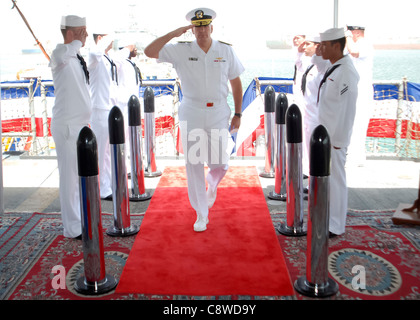 U.S. Navy Rear Adm. Scott Sanders salutes the side boys as he arrives to relieve Turkish Navy Rear Adm. Caner Bener - Stock Photo