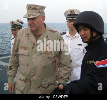 commander of Combined Task Force (CTF) 151 speaks with junior officers aboard the People's Liberation Army Navy - Stock Photo