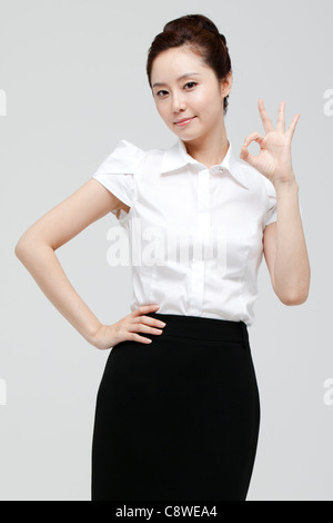 Asian Businesswoman Showing Ok Sign - Stock Photo