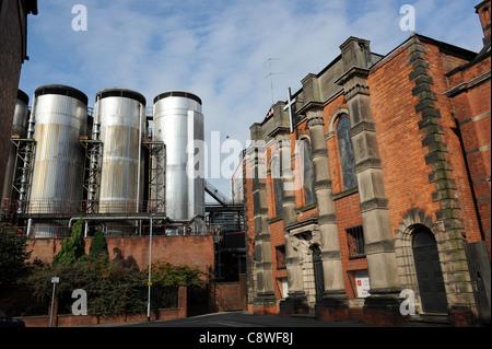 Molson Coors Burton Brewery next to Trinity Methodist Church at Burton-on-Trent Staffordshire England Uk - Stock Photo