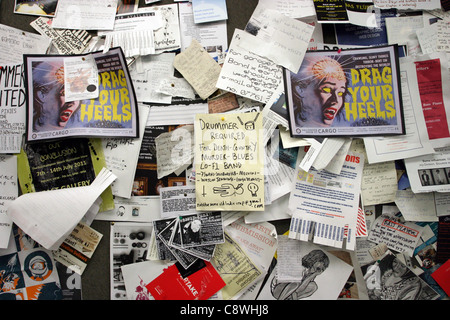 Adverts on a Music Shop Notice Board - Stock Photo