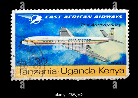 A postage stamp of East African airways in black background - Stock Photo