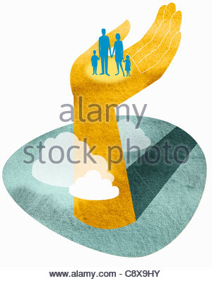 Family standing in large hand - Stock Photo
