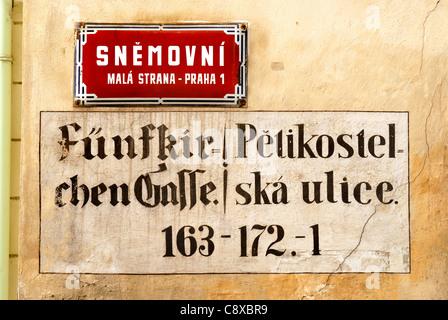 Prague, Czech Republic. New street sign and old German / Czech painted version. 'Five Church Street' - Stock Photo