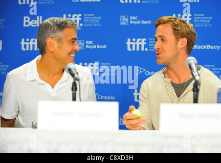 George Clooney Ryan Gosling atpress conferenceIDES MARCH Press Conference Toronto International Film Festival TIFF - Stock Photo