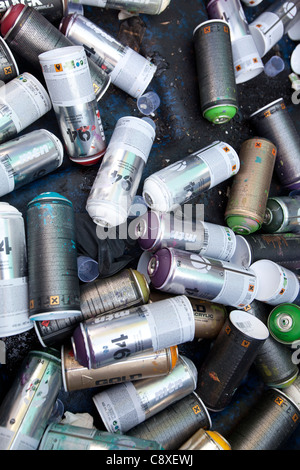 Empty paint spray cans used for graffiti in a dustbin in Nantes, France  - Stock Photo