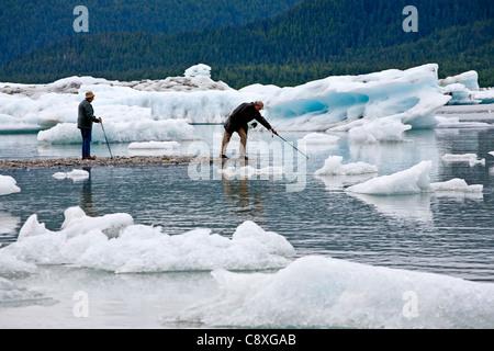 People and icebergs. Mendenhall Glacier lake. Juneau. Alaska. USA - Stock Photo