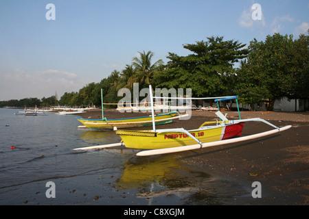 Traditional Fishing Boats Called Jukung On Lovina Beach, Bali - Stock Photo