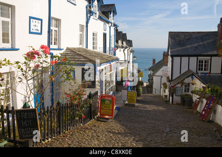 Clovelly North Devon October Narrow cobble main street to Old Post Office and Village Shop in private fishing village - Stock Photo