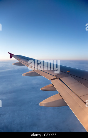 The view from the airplane at the clouds in the sky. - Stock Photo