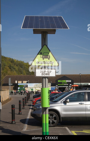 UK Ecotricity electric car charging point at Welcome Break motorway service station powered by solar panel - Stock Photo