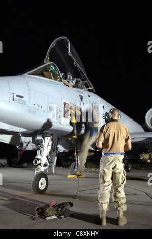 Two crew chiefs assist an A-10 Thunderbolt II pilot at Bagram Air Base, Afghanistan, after a mission July 6 in support - Stock Photo