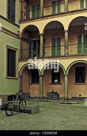 Backyard in an Italian city with bike - Stock Photo