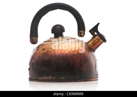 scorched kettle on white background - Stock Photo