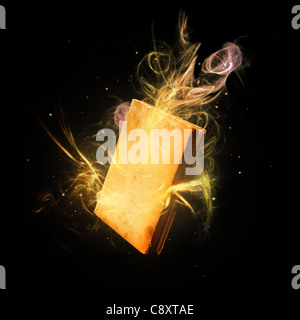 Closed magic book amazing colorful light rays and streaks. - Stock Photo