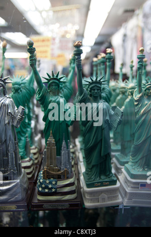 Statue of Liberty souvenirs for sale in a New York City shop window. - Stock Photo