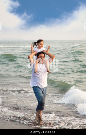 happy father with little girl on the beach - Stock Photo