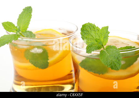 Closeup of iced tea with lemon on white background - Stock Photo