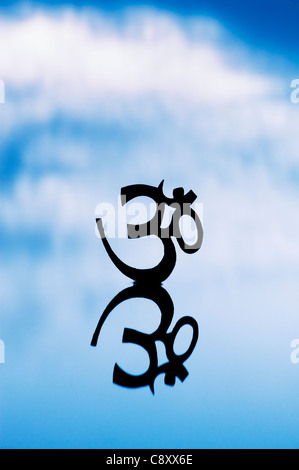 Sacred Aum Sanskrit Symbol In Circle Of Peacock Feathers Stock Photo