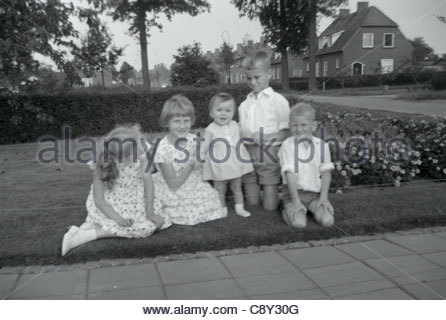Girls and boys posing for a family picture. 1960s Holland - Stock Photo