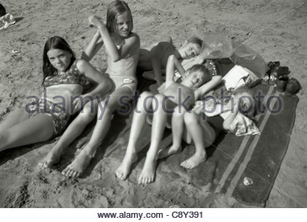 All together resting and sunning after a swim Holland 1960s - Stock Photo
