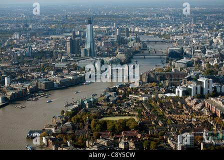 The River Thames with Tower Bridge in London England UK from the air. - Stock Photo