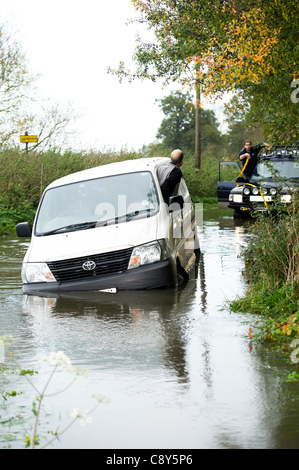Buttsbury Wash, Billericay Essex, UK. 4th November 2011. A van becomes stuck in the wash (a ford) at Buttsbury after - Stock Photo