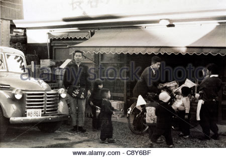 owner in front of the family grocery and liquor store Japan Yokosuka 1950s - Stock Photo