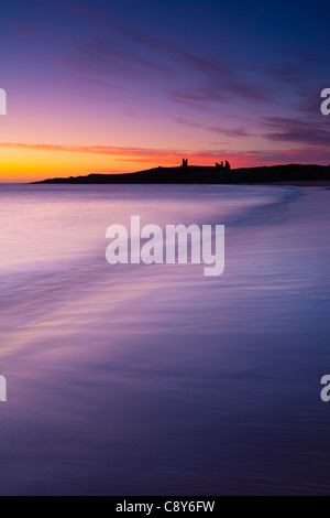 England, Northumberland, Embleton Bay. A colourful display of pre-dawn colours relected upon the wet sands of Embleton - Stock Photo