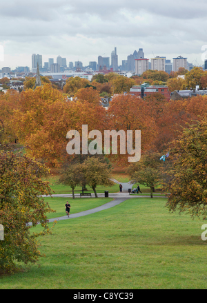 London, UK. London Skyline with Regents Park in the foreground in full autumn colours on FRIDAY 4th November. - Stock Photo