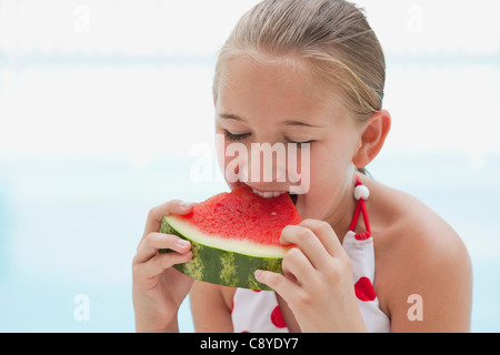 USA, Florida, St. Petersburg, Girl (10-11) eating watermelon - Stock Photo