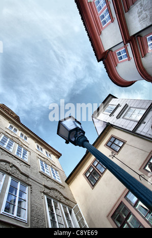 Wide angle shot of narrow street. Prague. Czech Republic - Stock Photo