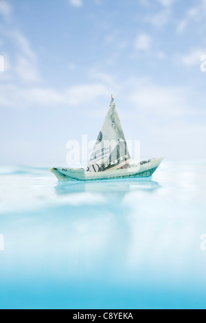 USA, Florida, St. Petersburg, Boat made of fifty dollar banknote floating on water - Stock Photo