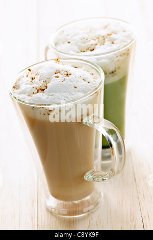 Two specialty tea latte beverages of chai and matcha teas - Stock Photo