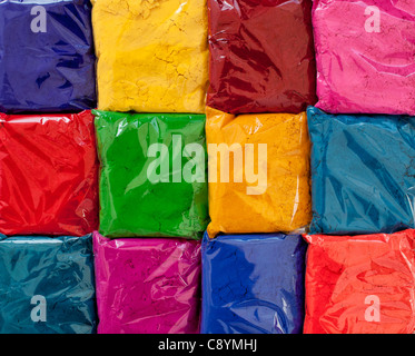Bags of Indian coloured powder used for amking rangoli designs on the street. India - Stock Photo