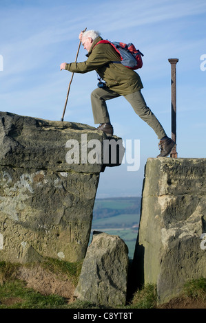 Grandfather climbing Roseberry topping in North yorkshire uk - Stock Photo