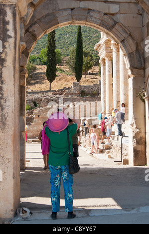 Tourist takes photo of the library Celsus bibliotheque in the ancient town of Ephesus in Turkey. - Stock Photo