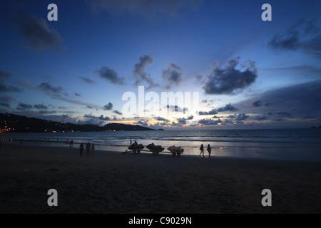 Patong beach and jetski at sunset - Stock Photo