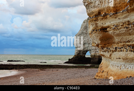 Image of stones and ocean.Location: La Falaise d'Amont in Etretat on the Upper Normandy coast in the North of France. - Stock Photo