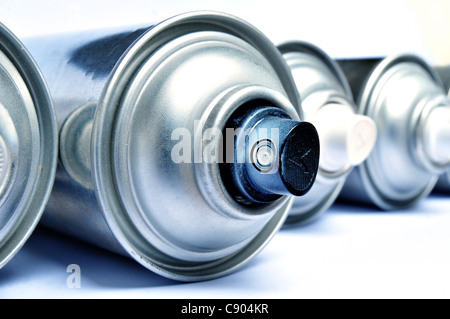 Aerosol cans over white background - Stock Photo
