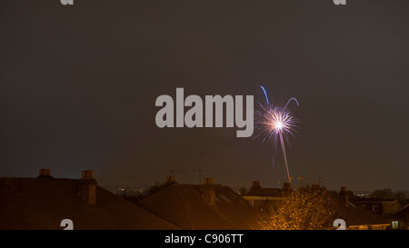 Firework display above houses in London on November 5th 2011 - Stock Photo