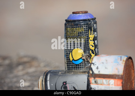 spray paint cans discarded after being used for graffiti - Stock Photo